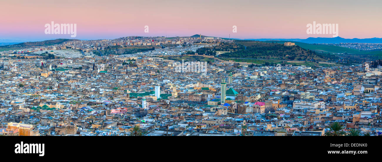 Elevated view across the Old Medina of Fes illuminated at dusk, UNESCO World Heritage Site, Fes, Morocco, North Africa, Africa - Stock Image