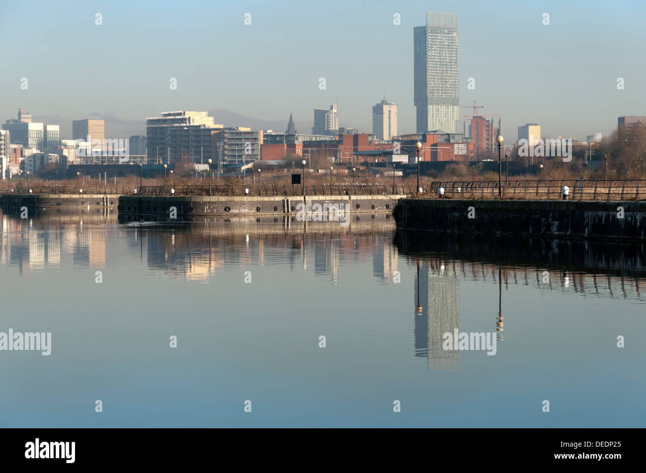 City centre skyline over the River Irwell (Manchester Ship Canal), Manchester, England, UK.  Beetham Tower on right. - Stock Image