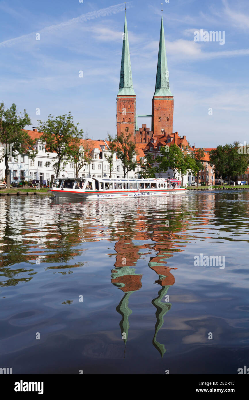 Excursion boat on the River Trave and cathedral, Stadttrave, Lubeck, Schleswig Holstein, Germany, Europe - Stock Image