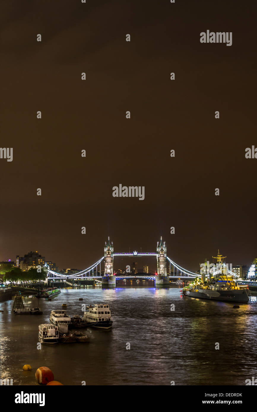 Night Shot of Tower Bridge and the Thames River in London, UK - Stock Image