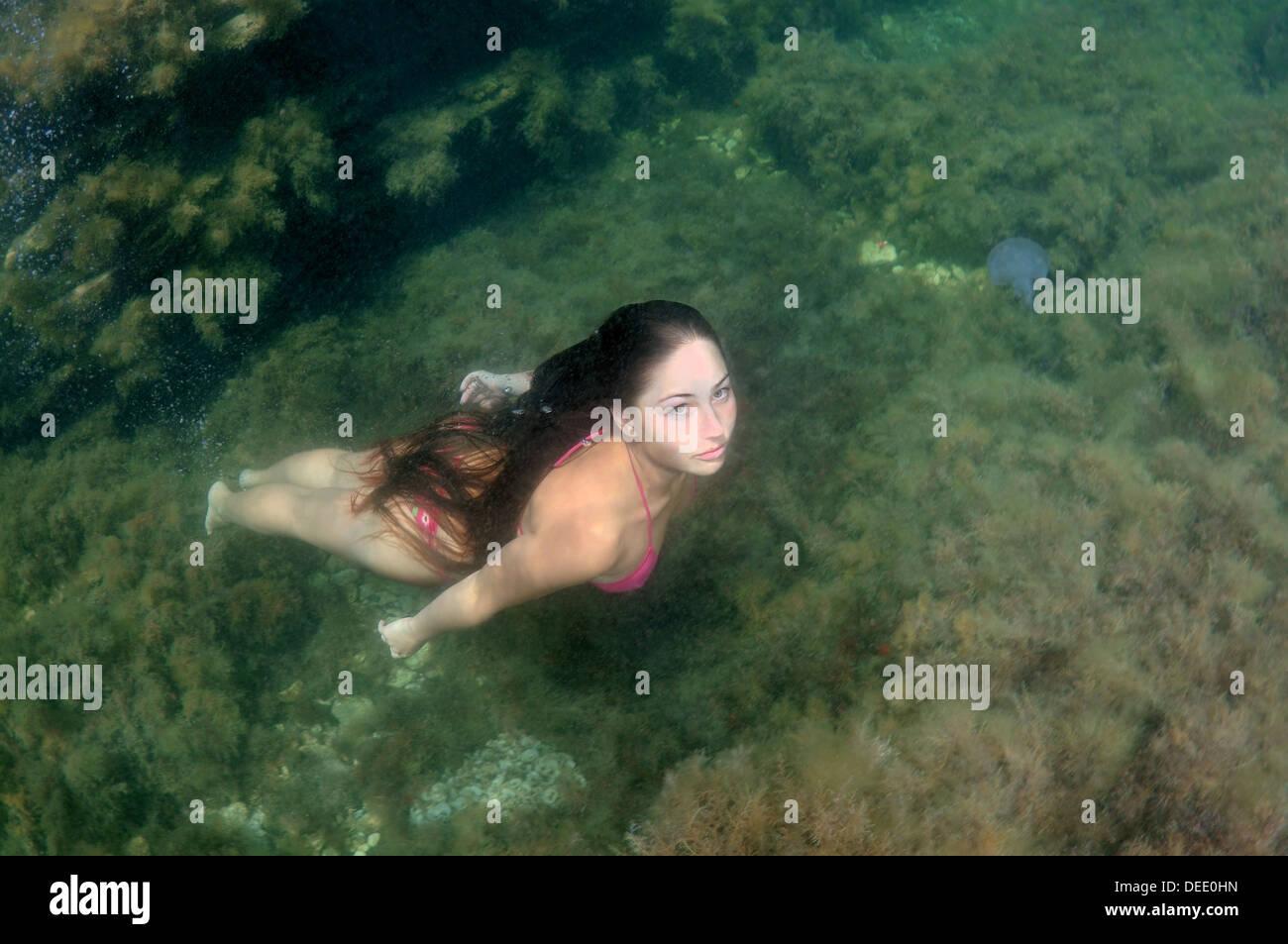 woman dives into the water, Black sea, Crimea, Ukraine, Europe - Stock Image