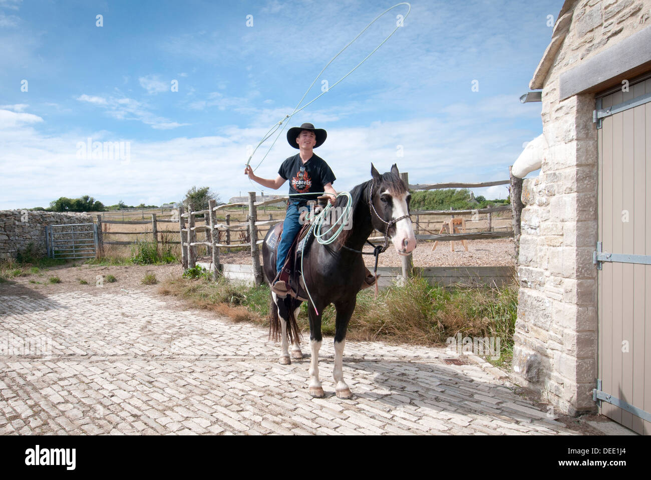 cowboy swinging a lasso - Stock Image