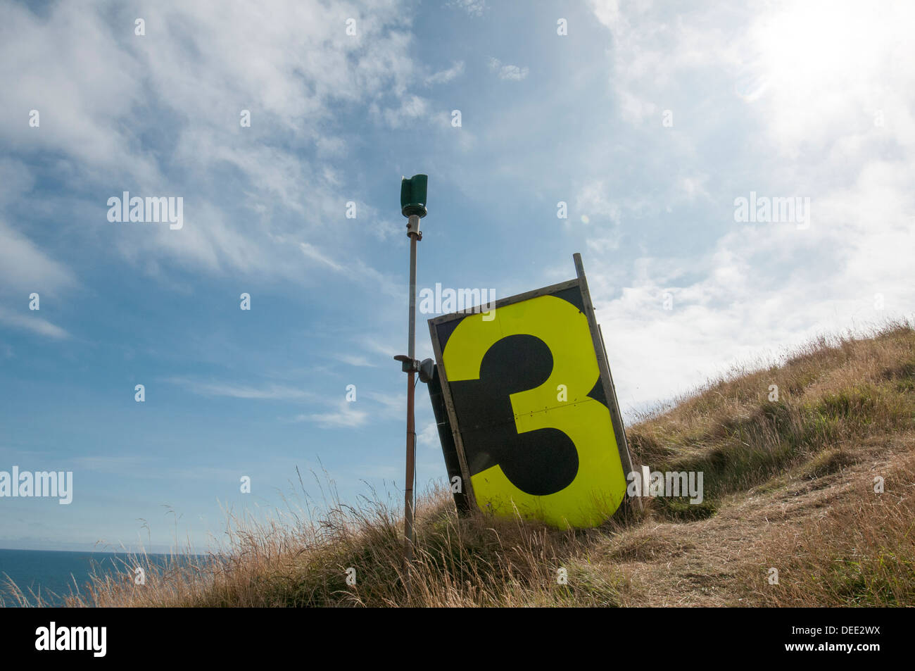 large number three, MOD target on Worbarrow Ranges on top of Worbarrow Tout - Stock Image