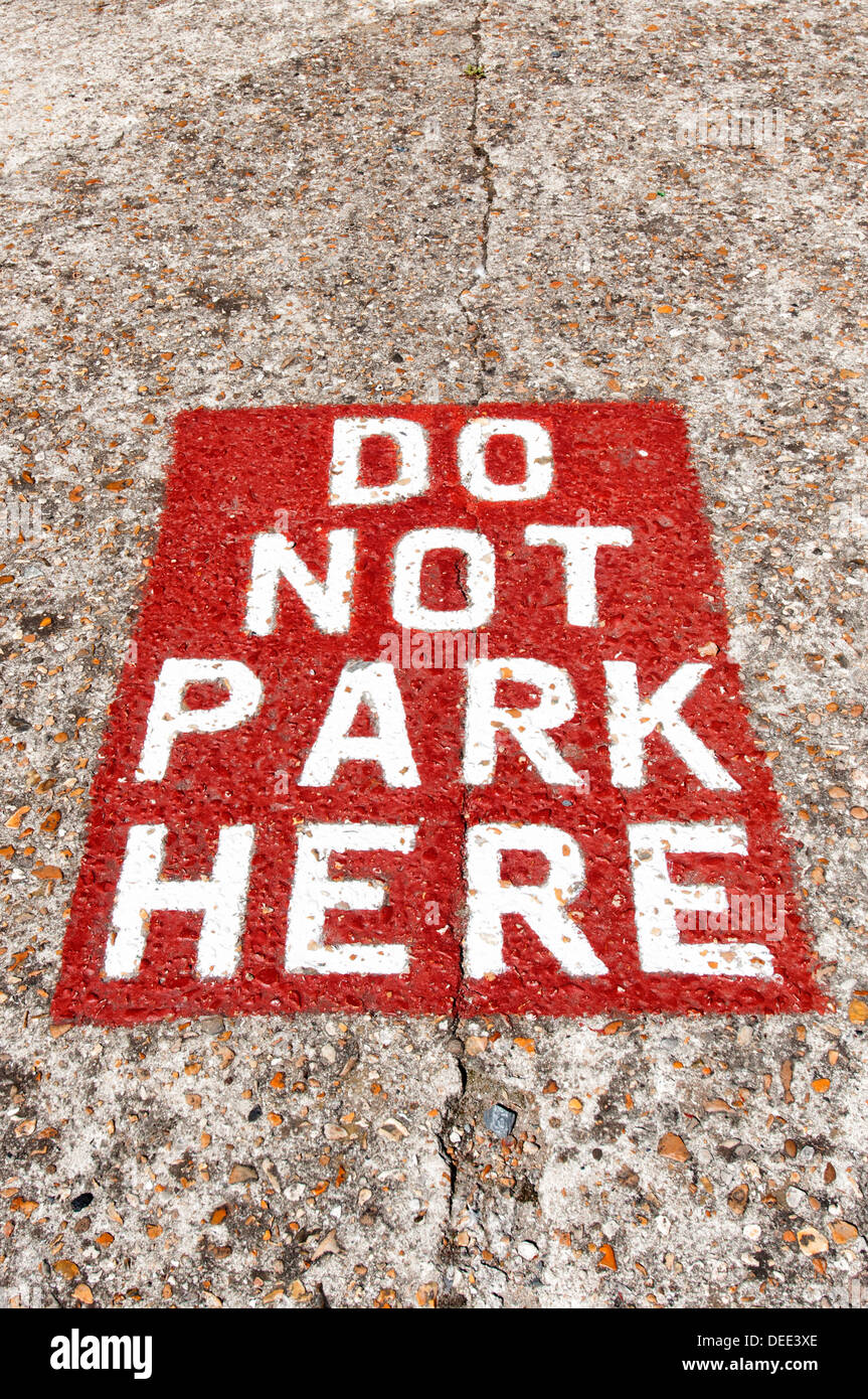 do not park here sign painted on the road - Stock Image
