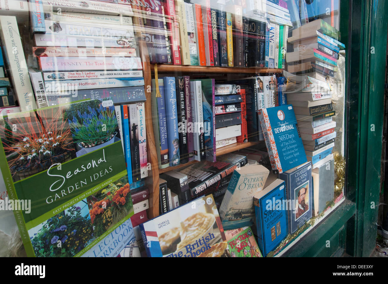 bookshop window with secondhand books - Stock Image