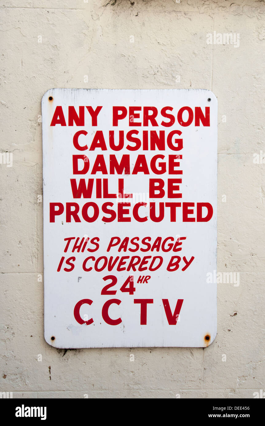 any person causing damage will be prosecuted sign on a wall - Stock Image