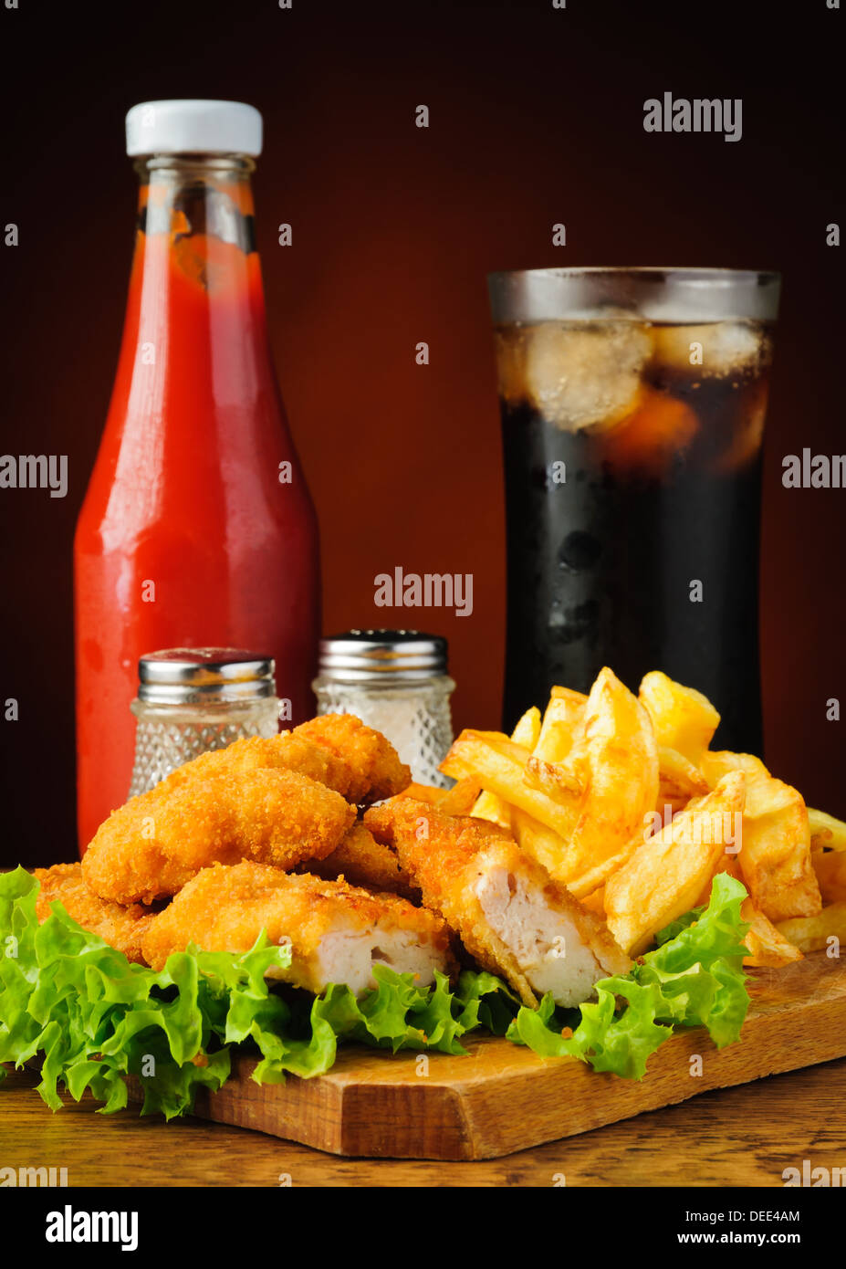 still life with chicken nuggets menu, french fries, cola and tomato ketchup - Stock Image