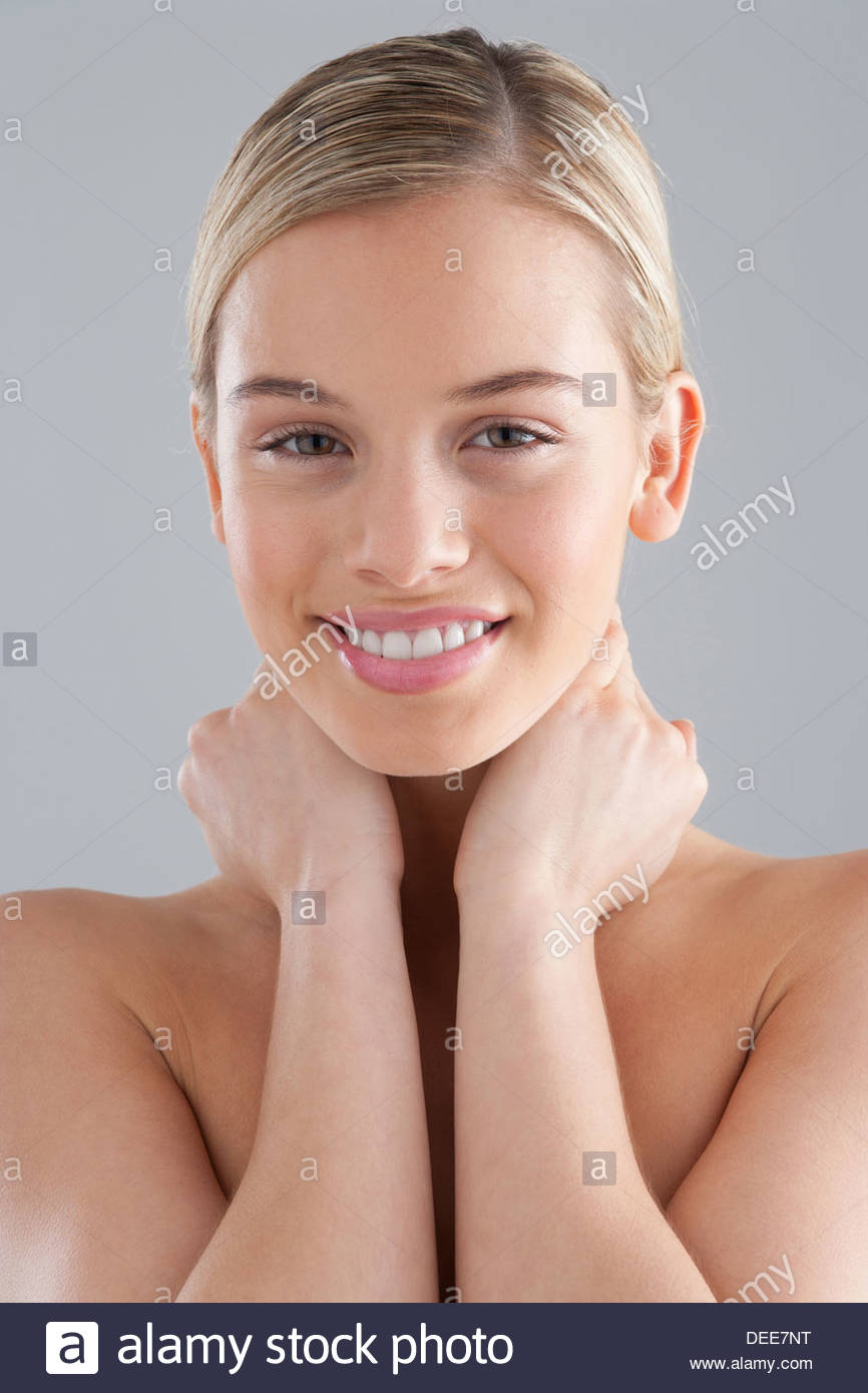 Woman with hands on neck - Stock Image