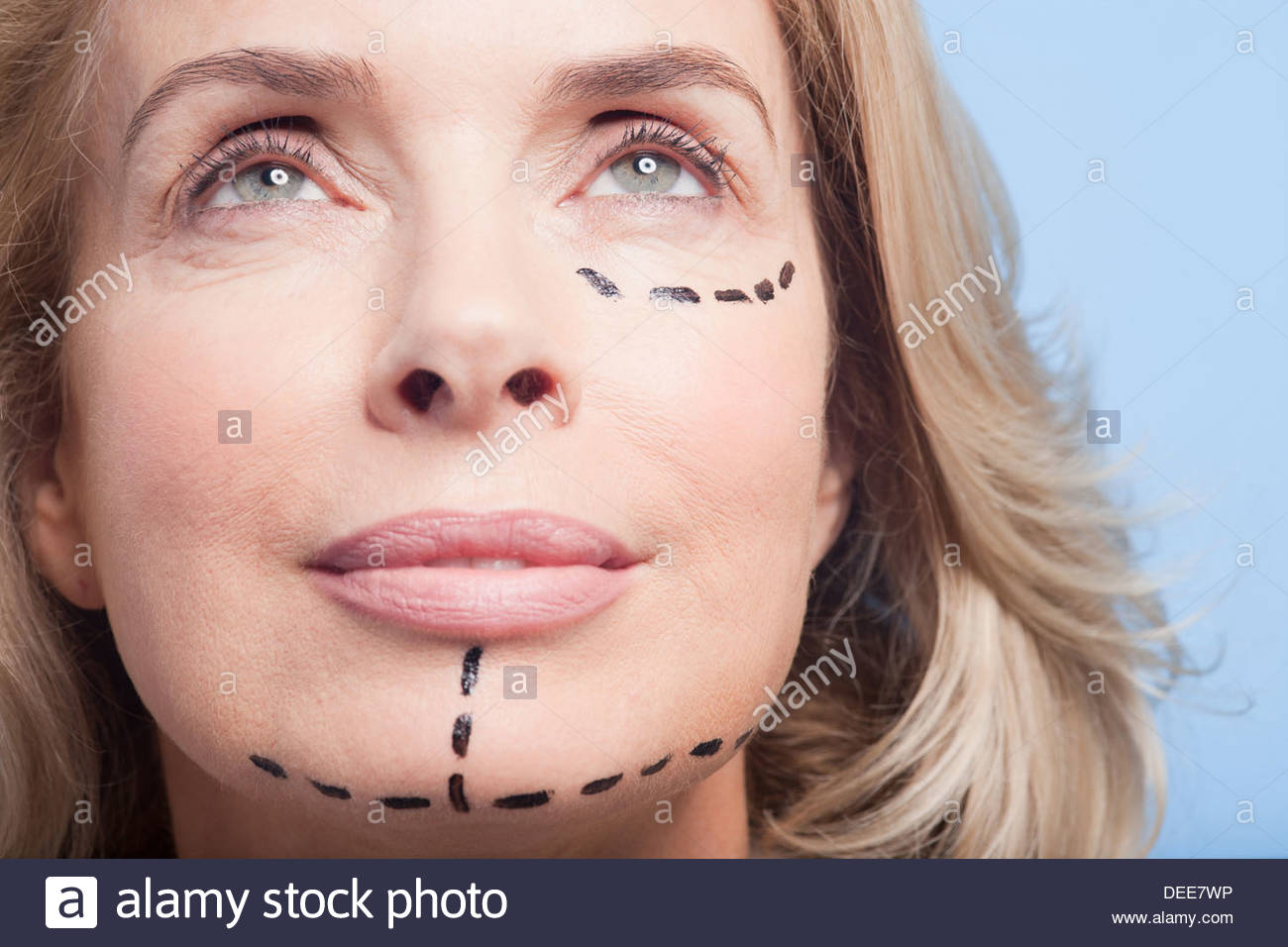 Close up portrait of woman with dotted lines on face - Stock Image