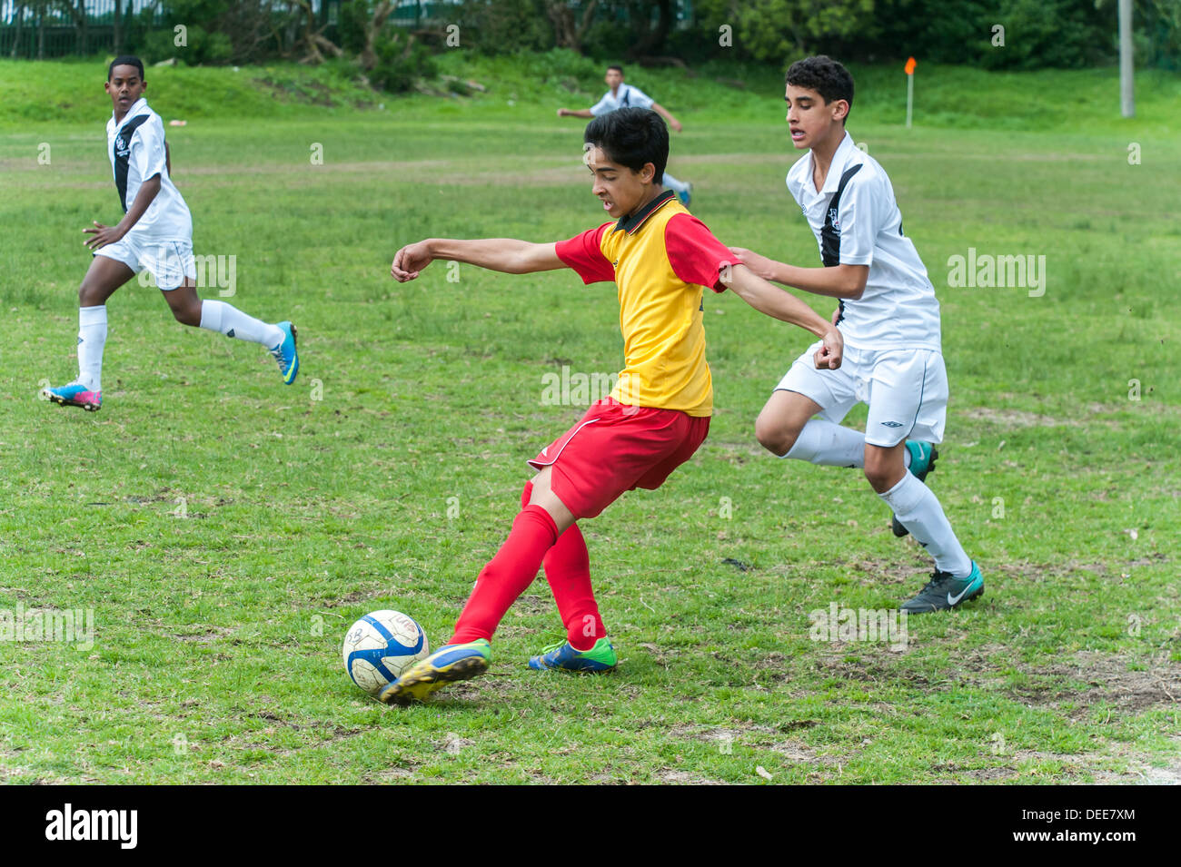 Junior football player passing the ball , Cape Town, South Africa - Stock Image