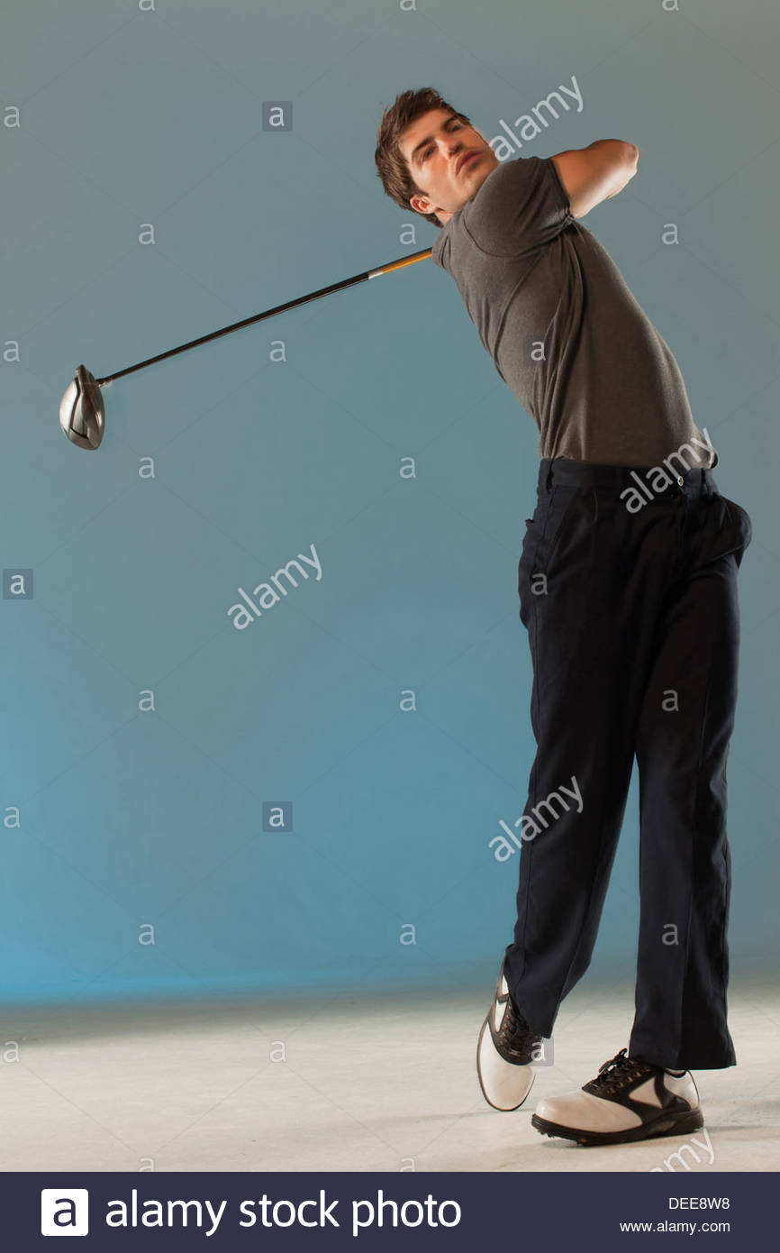golf player swinging club - Stock Image