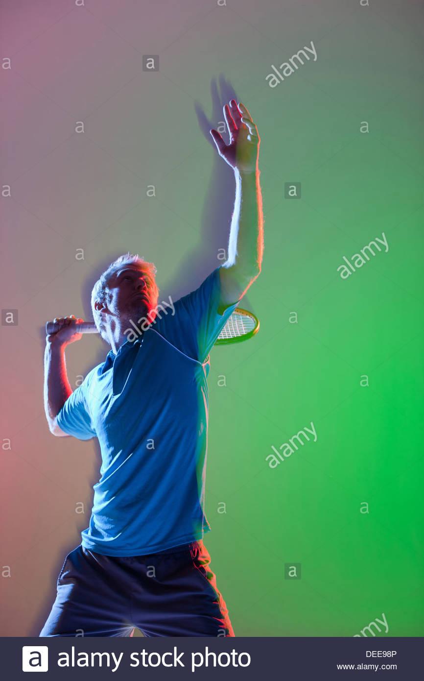 Tennis player swinging racket - Stock Image