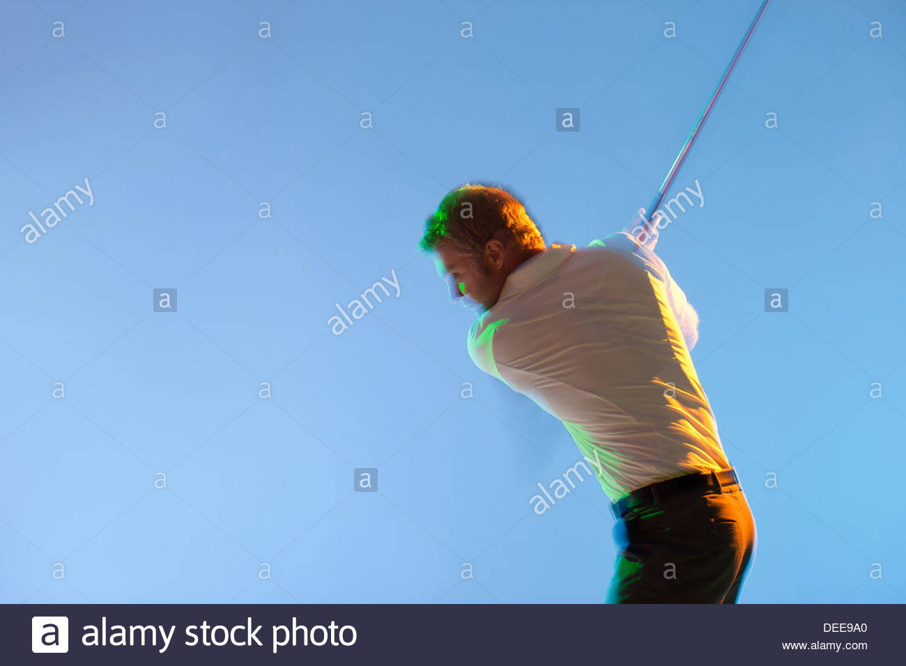 Blurred view of golf player swinging club - Stock Image