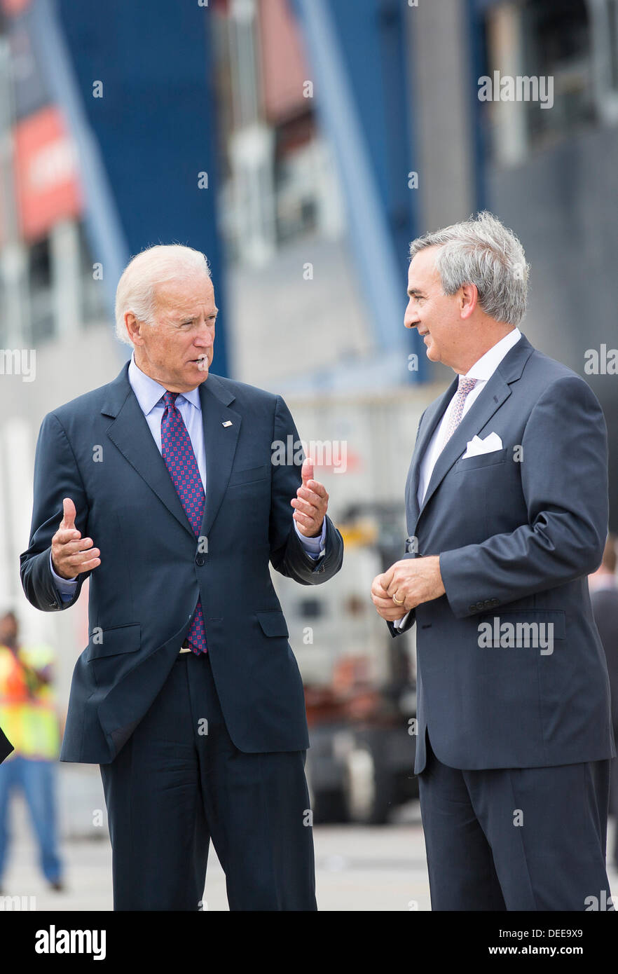 US Vice President Joe Biden talks with Charleston Ports Authority CEO Jim Newsome during a visit to Wando Welch Terminal on September 16, 2013 in Charleston, South Carolina. Biden spoke about the need to improve America's transportation infrastructures for exports and economic growth. - Stock Image