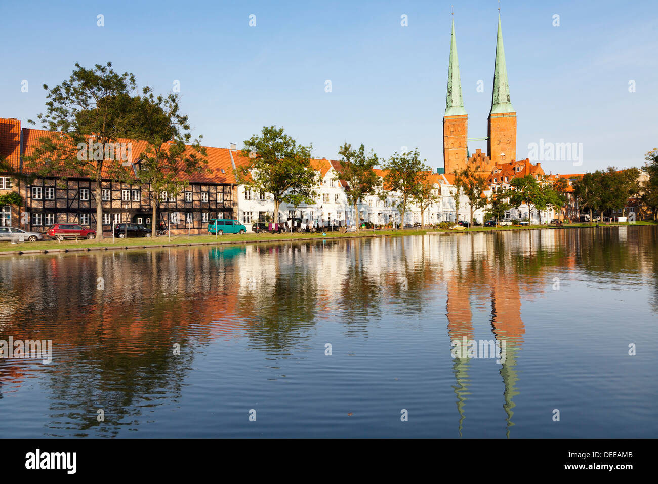 Cathedral reflected in the River Trave, Stadttrave, Lubeck, Schleswig Holstein, Germany, Europe - Stock Image