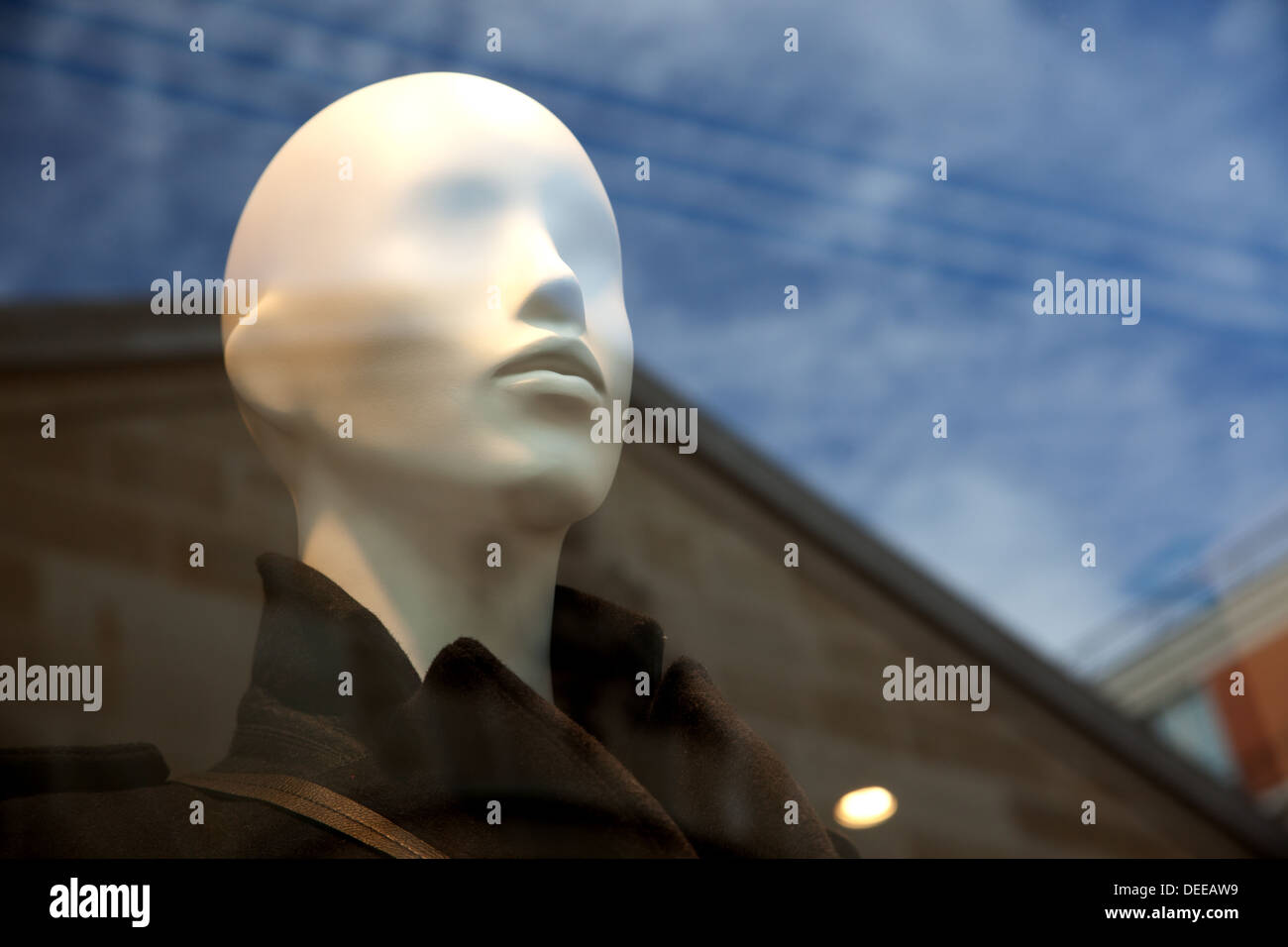 Mannequin behind a shop window. - Stock Image