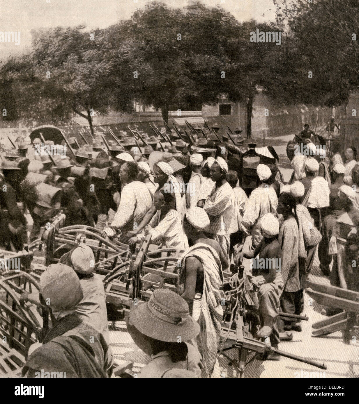 American Marines entering Tientsin, China, during the Boxer Rebellion, 1900. Halftone reproduction of a photograph - Stock Image