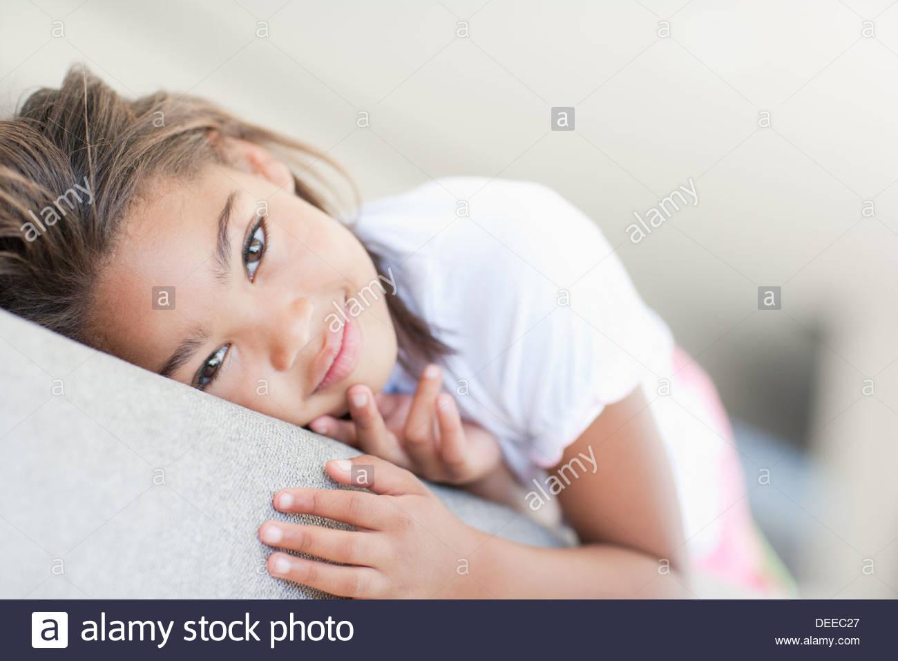 African girl laying on sofa Stock Photo