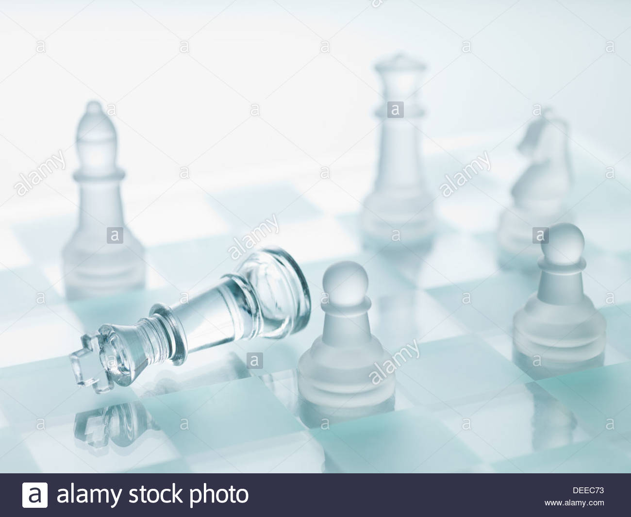 Close up of glass chess pieces - Stock Image