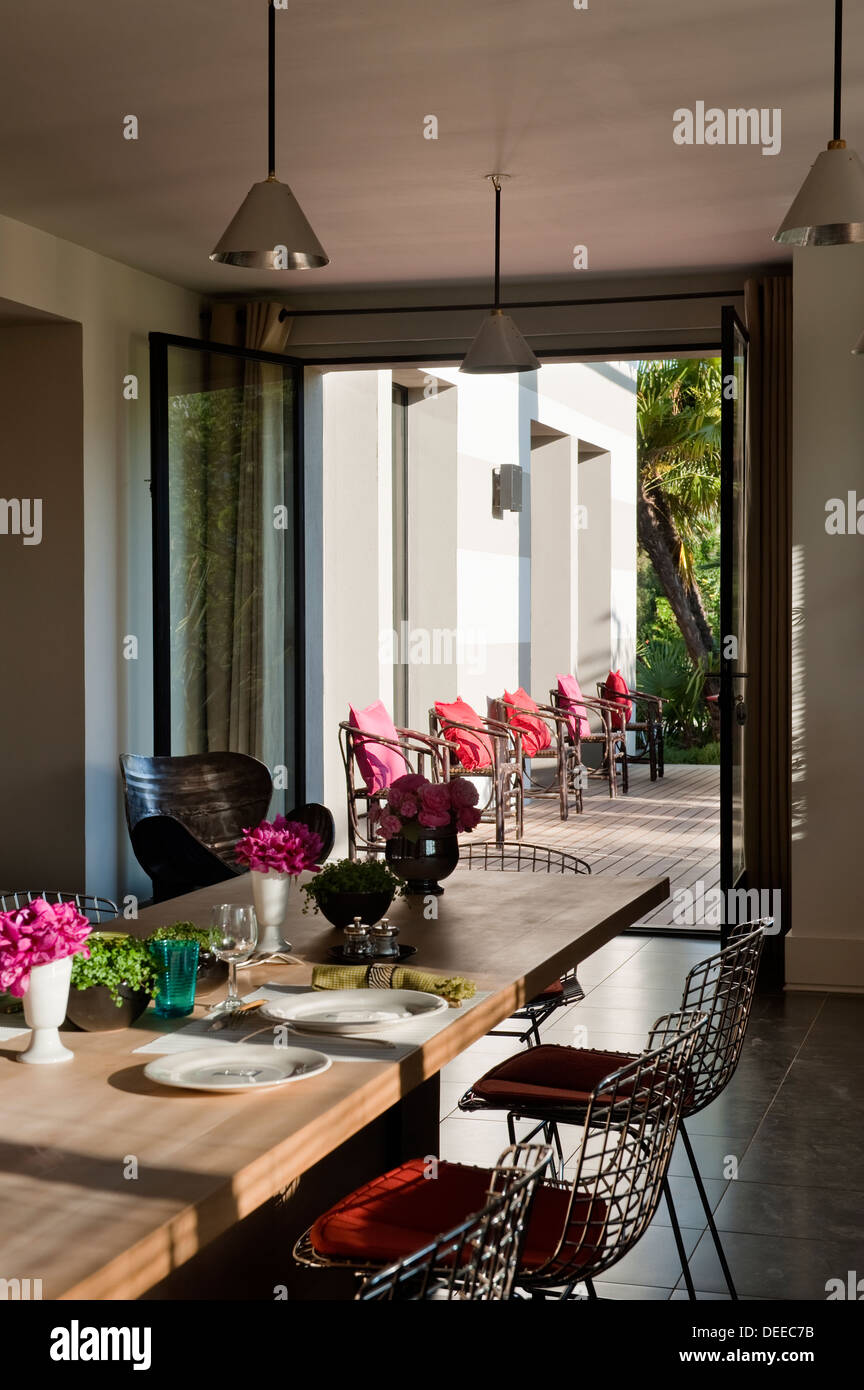 View through dining room doors to terrace in the home of Bruno and Dominique Lafourcade in Provence - Stock Image