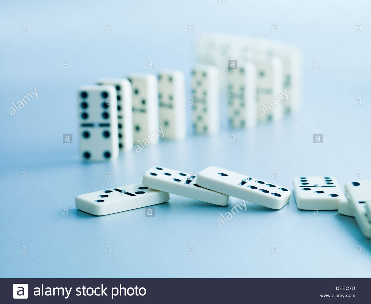 Dominoes fallen - Stock Image