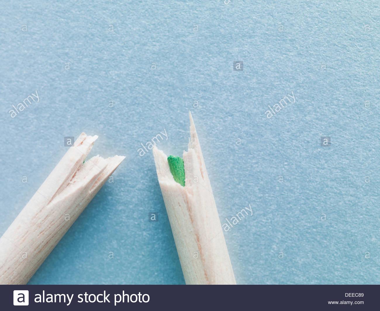 Broken color pencil pieces - Stock Image