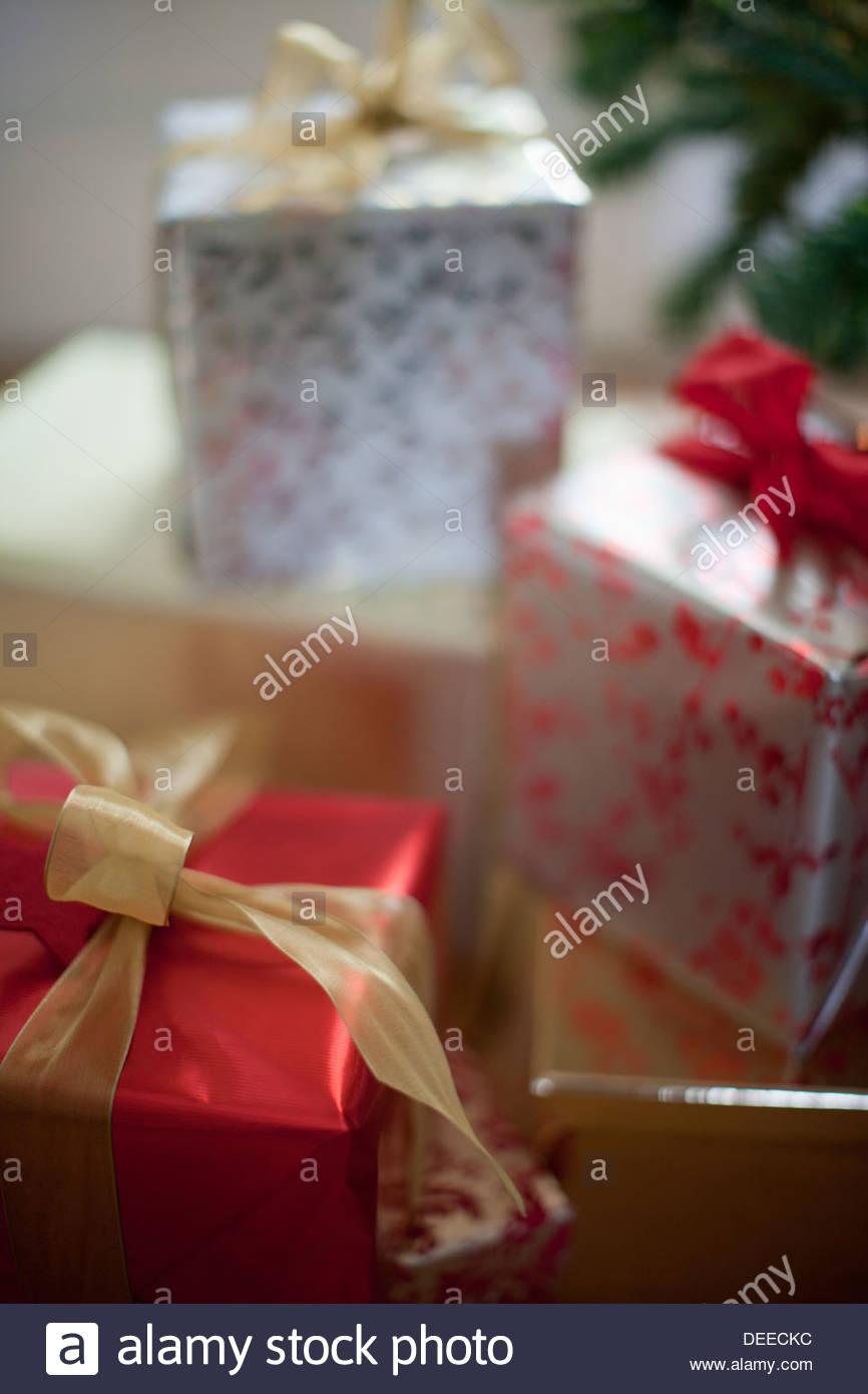 Christmas gifts beneath tree - Stock Image
