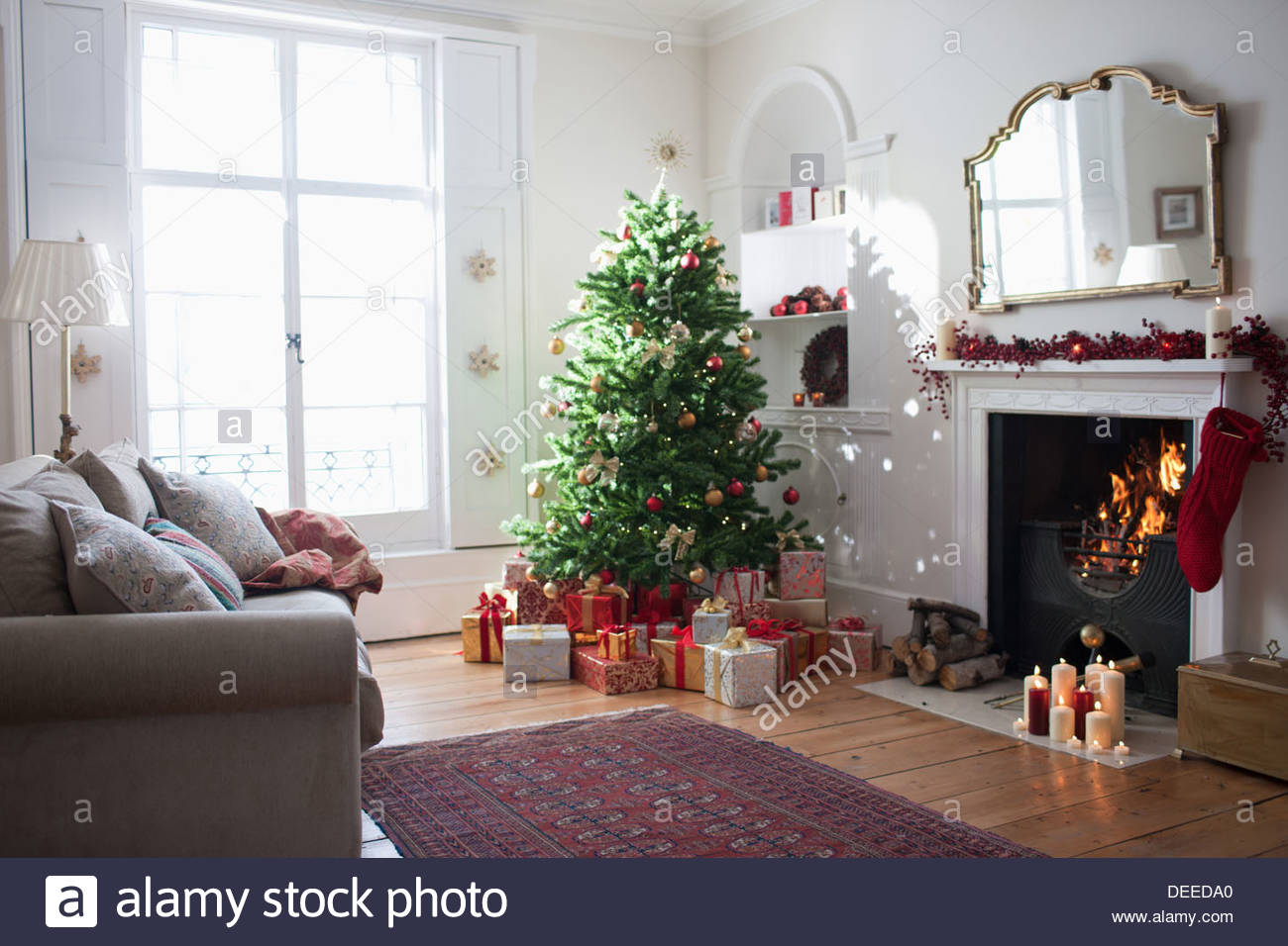 Christmas tree surrounded with gifts - Stock Image