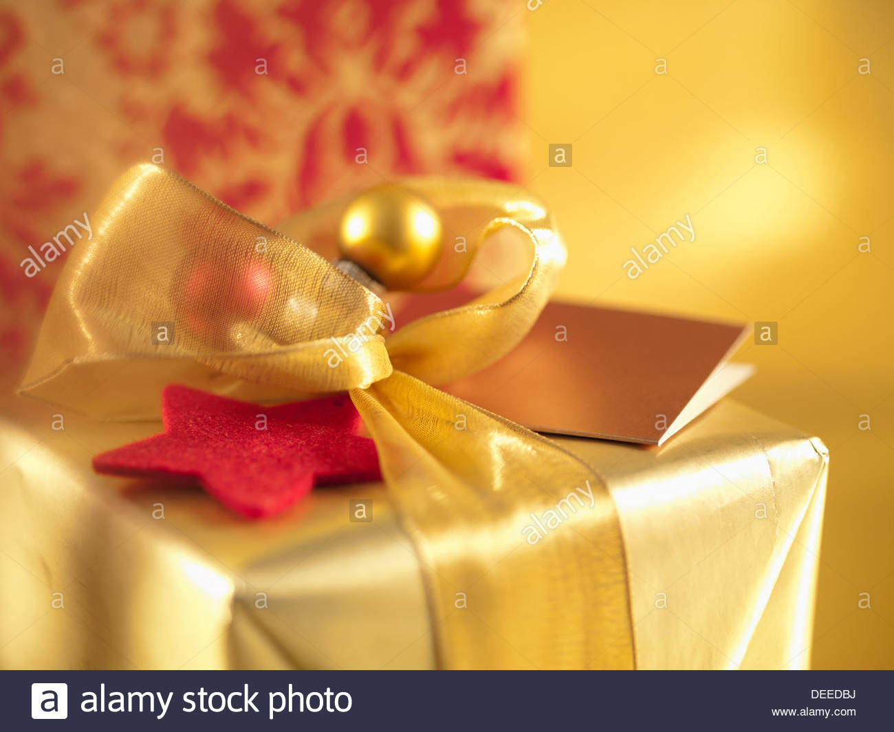 Christmas gifts with gold ribbons - Stock Image