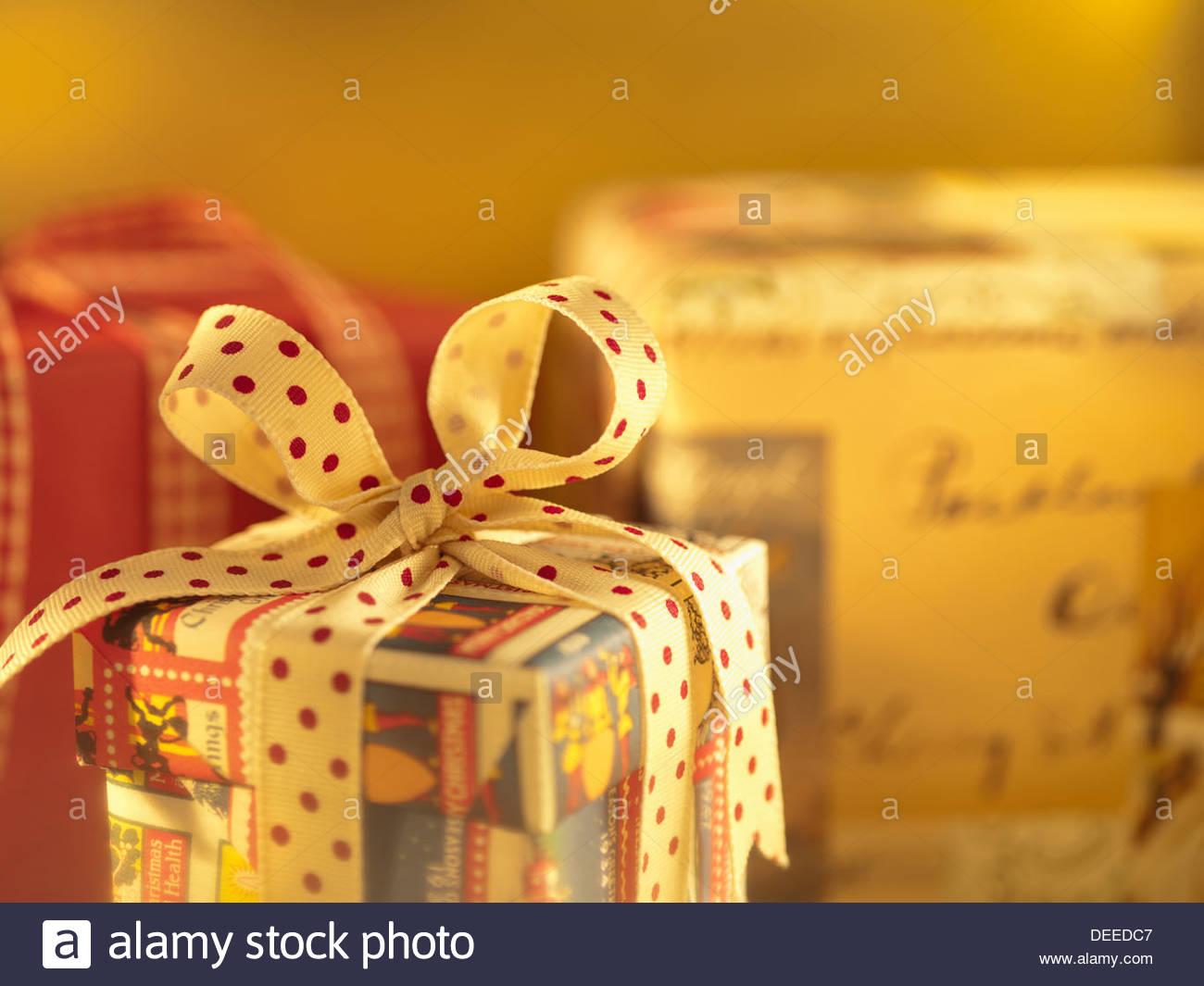 Christmas gift with polka dot ribbon - Stock Image