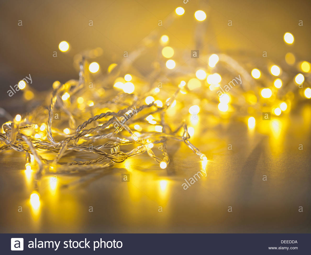 Pile of illuminated string lights - Stock Image
