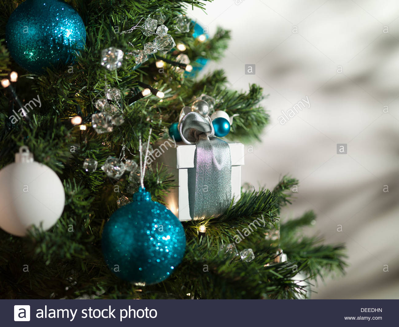 Christmas gift and ornaments on tree - Stock Image