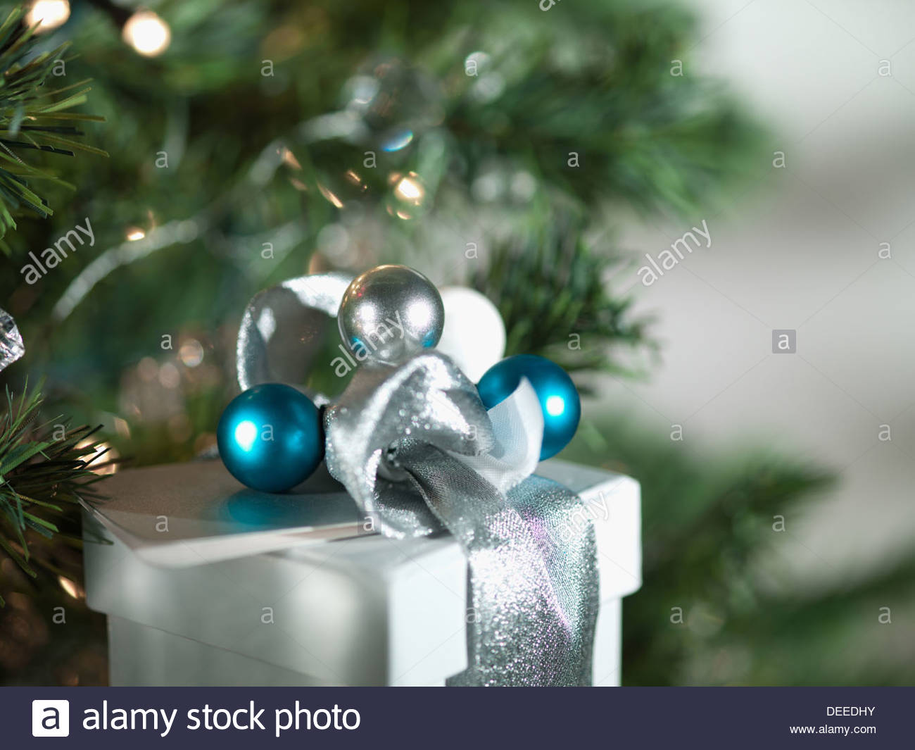 Christmas gifts with silver ribbon and wrapping - Stock Image