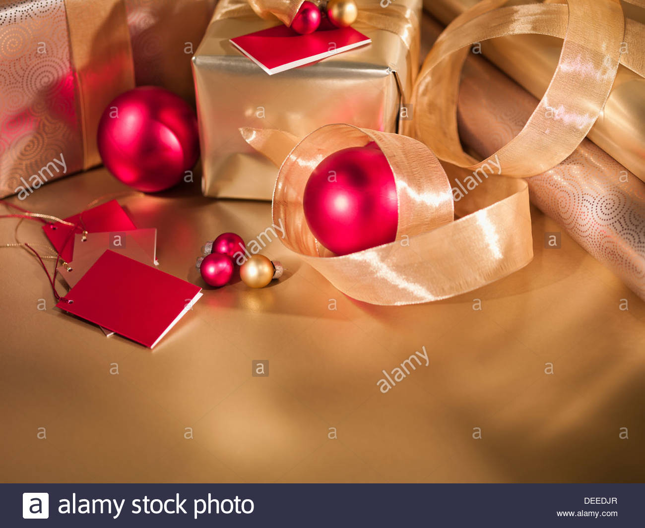 Christmas ornaments, ribbon and gifts - Stock Image