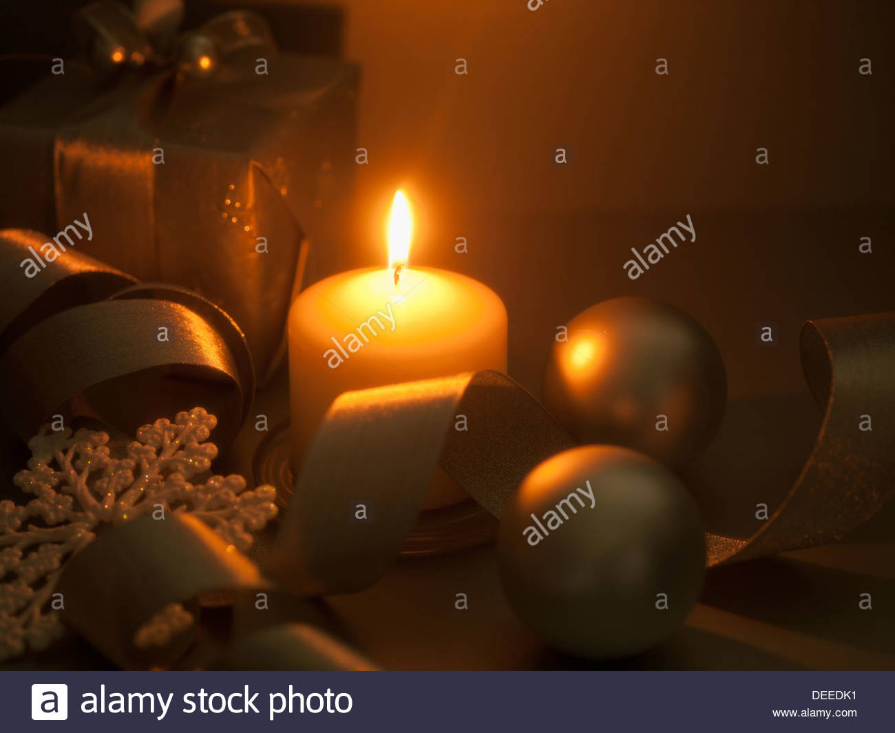 Christmas gifts, ornaments and candle - Stock Image