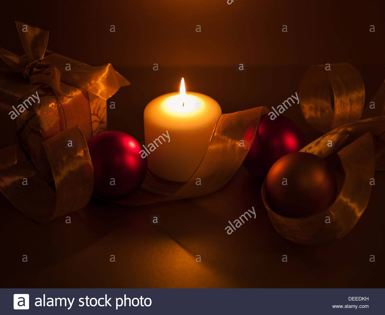 Christmas ornaments with ribbon and candle - Stock Image