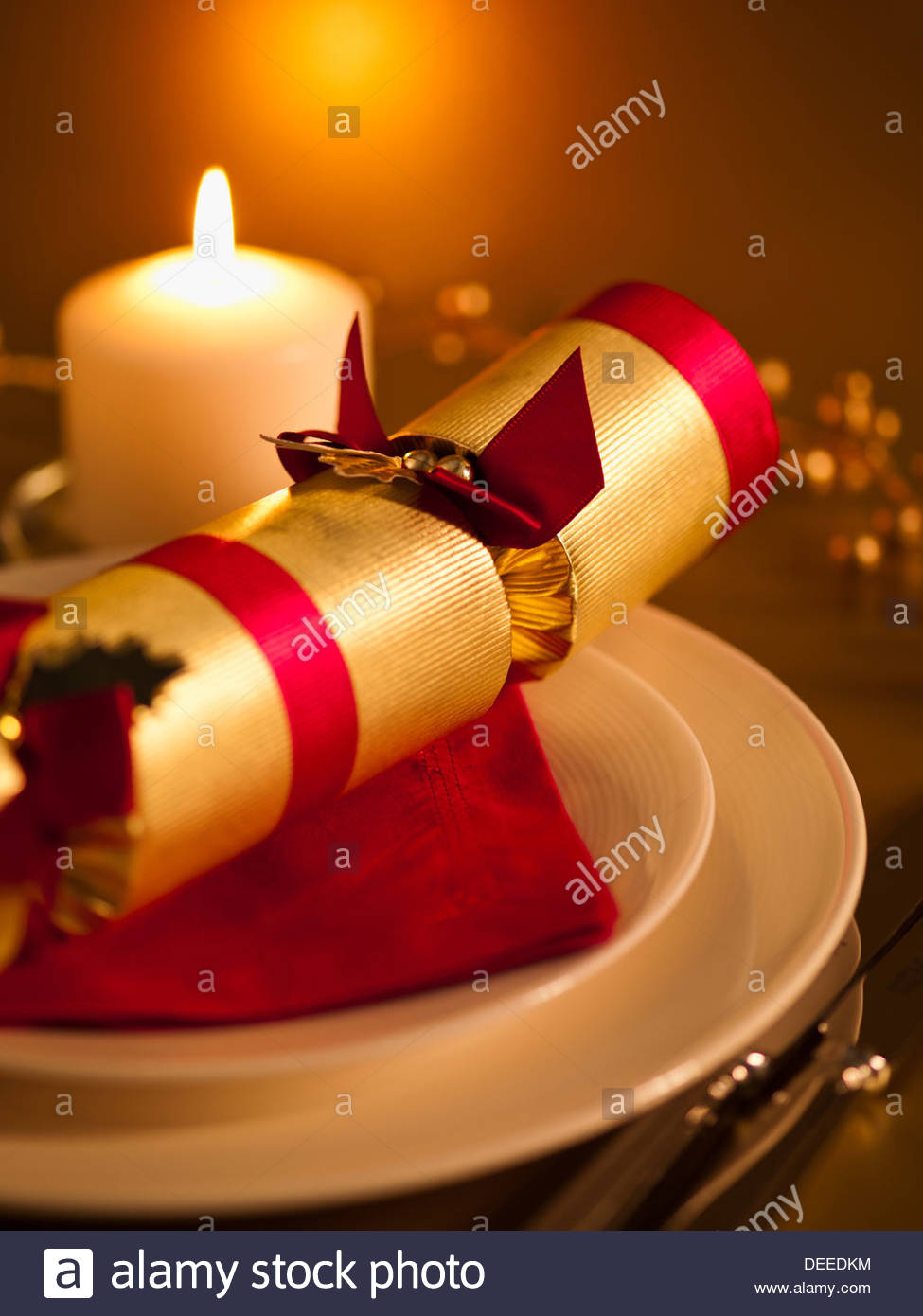 Ornate placesetting and candle - Stock Image