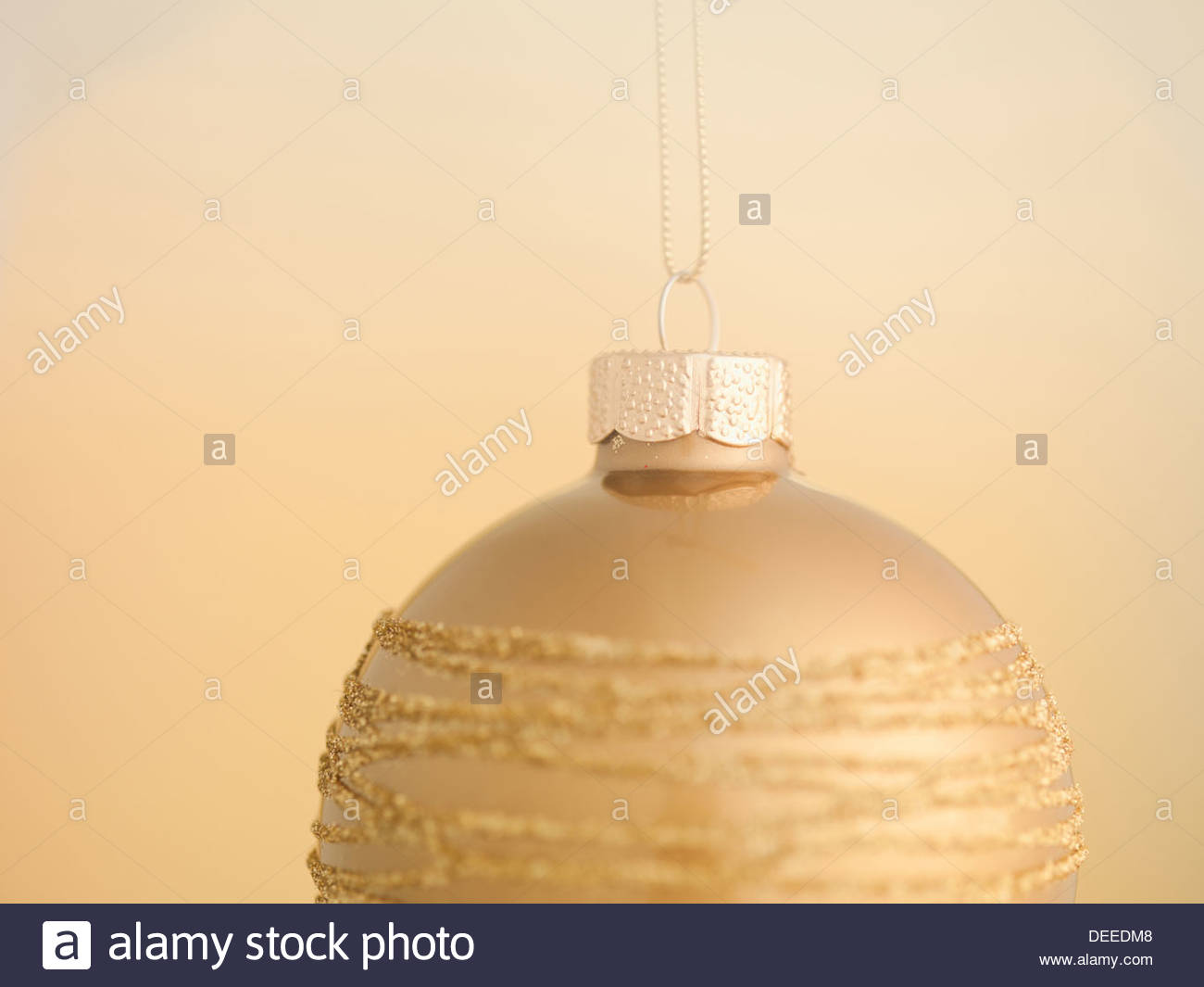 Close up of Christmas ornament hanging on string - Stock Image