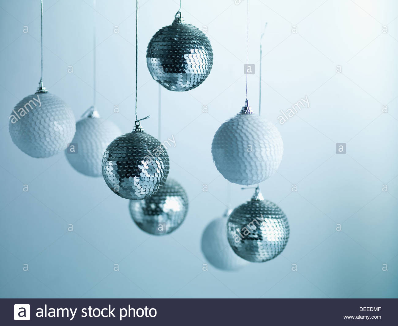 Christmas ornaments hanging from string - Stock Image