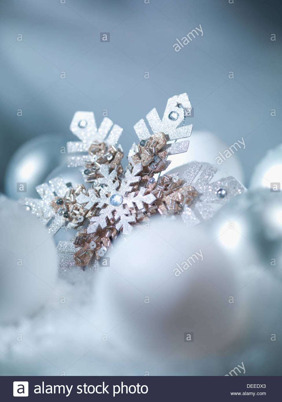 Pile of Christmas ornaments in snow - Stock Image