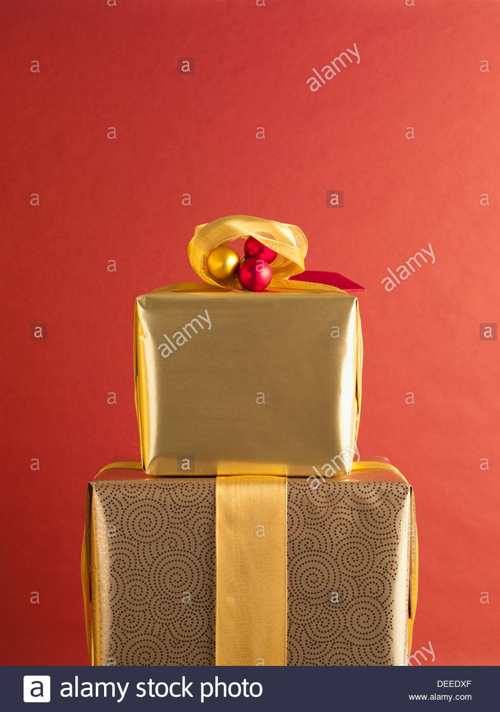 Christmas gifts with gold ribbon - Stock Image
