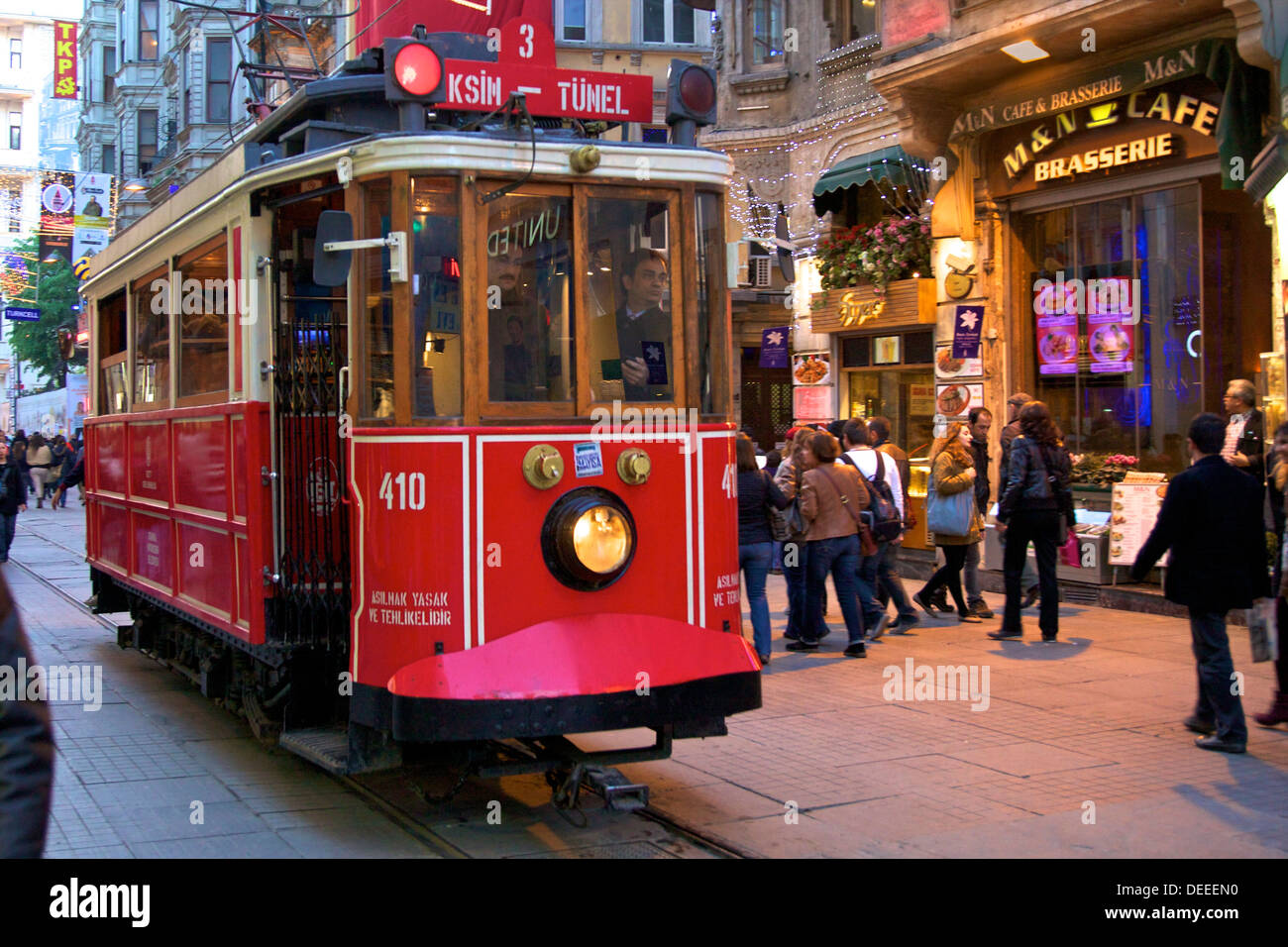 Historic red tram on Istiklal Caddesi, Beyoglu, Istanbul, Turkey, Europe - Stock Image