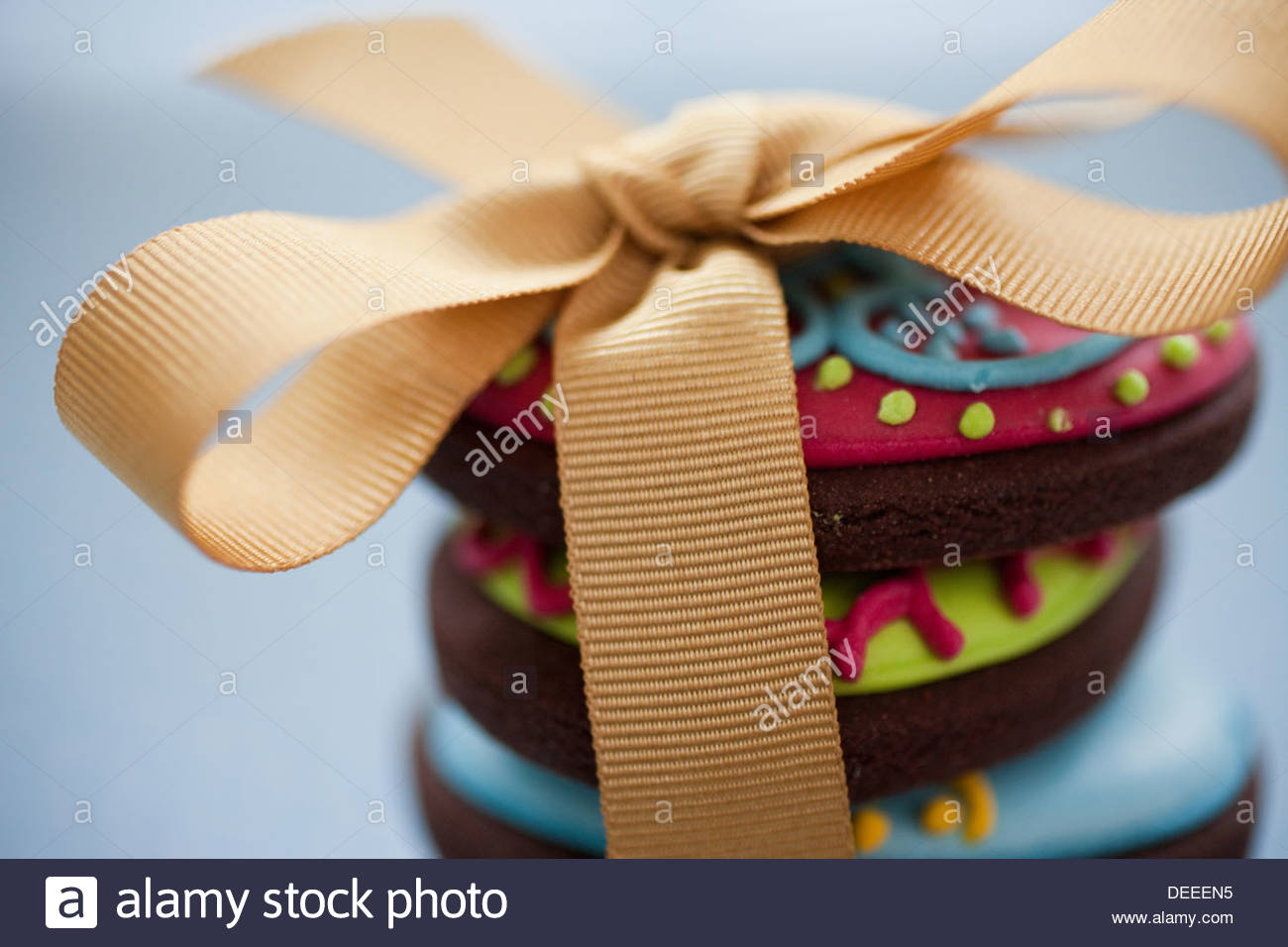 Close up of decorated Easter cookies in stack tied with ribbon - Stock Image