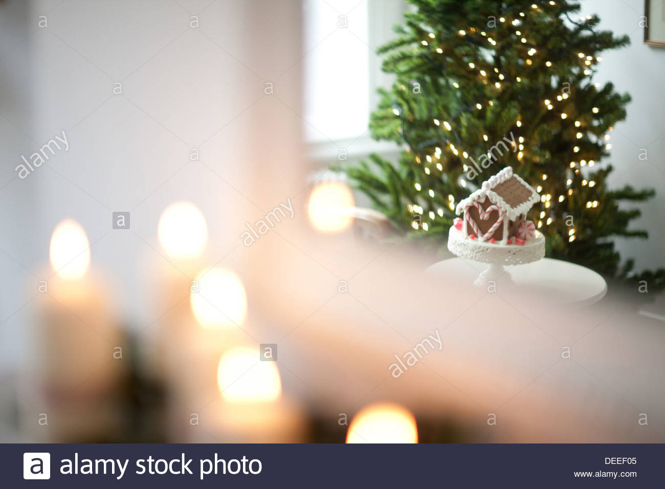 Blur candles lit on mantelpiece - Stock Image