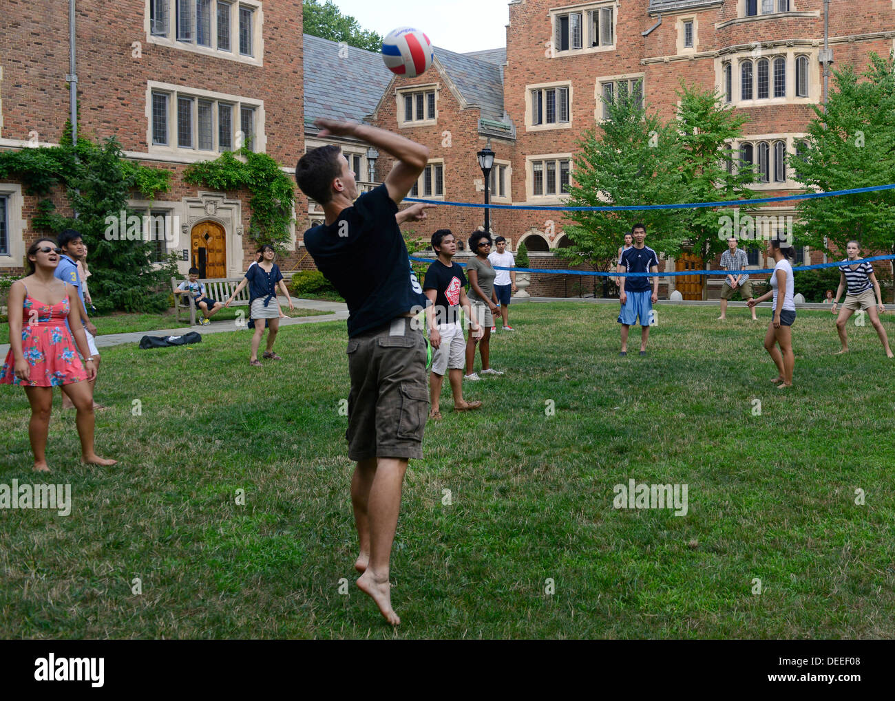 Yale University students at summer school play pick up volleyball after dinner at Calhoun Residential College. - Stock Image