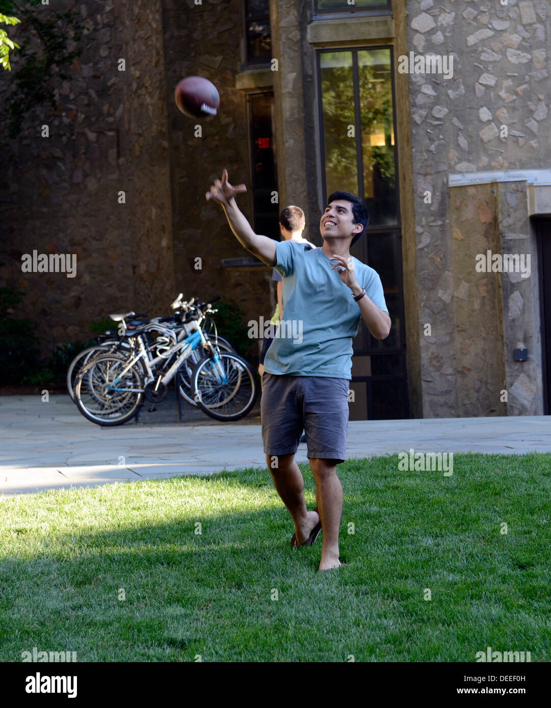 Yale University students attending summer school plays catch after dinner at Morse Residential College. - Stock Image