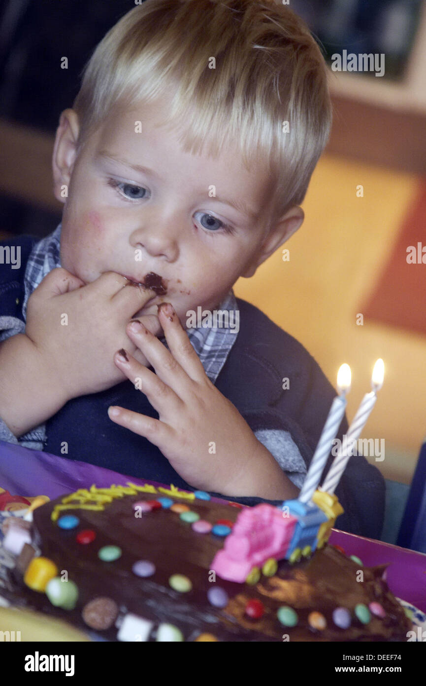 Peachy 2 Year Old Boy Looking At His Birthday Cake With Chocolate Round Funny Birthday Cards Online Elaedamsfinfo