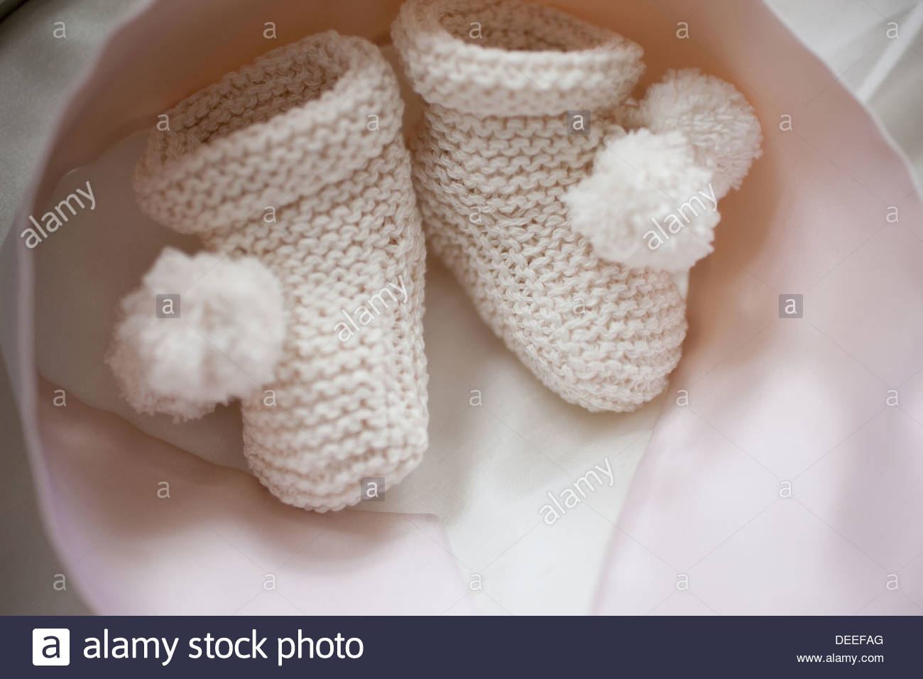 Close up of knit baby booties - Stock Image