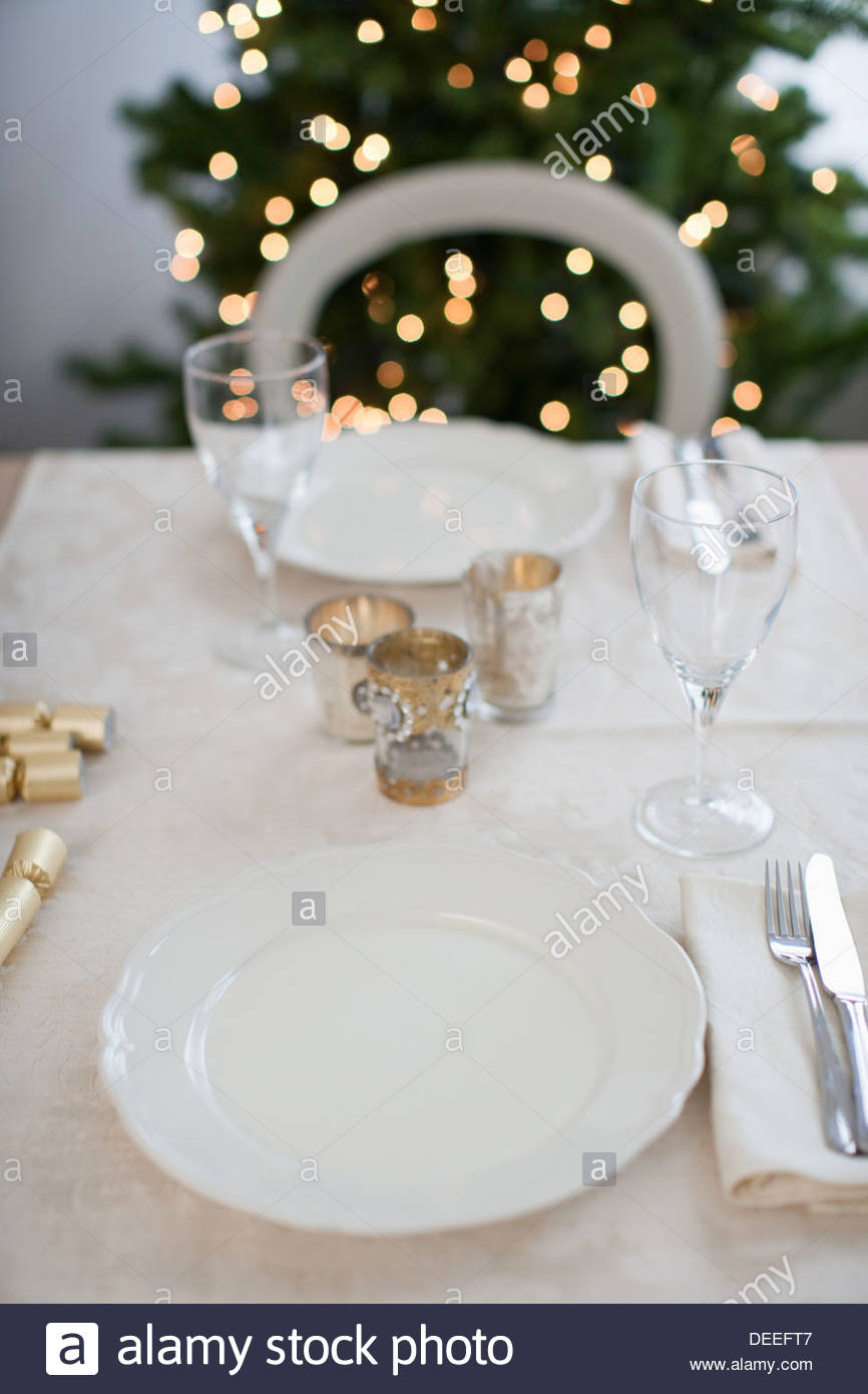 Dining table, Christmas tree in background - Stock Image