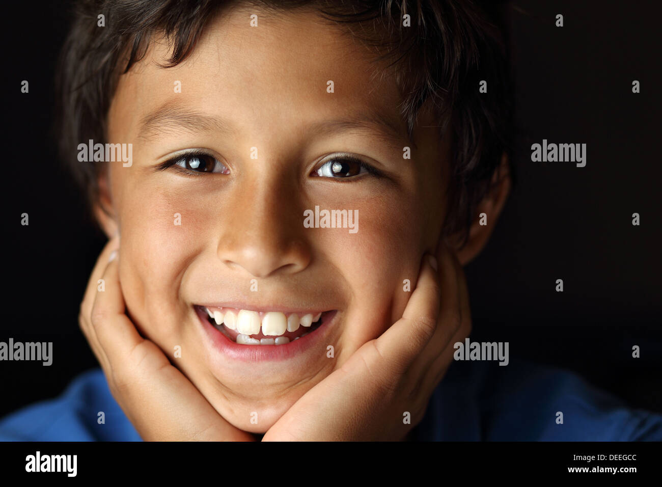 Portrait of young school boy with chiaroscuro lighting - shallow depth of field - Stock Image